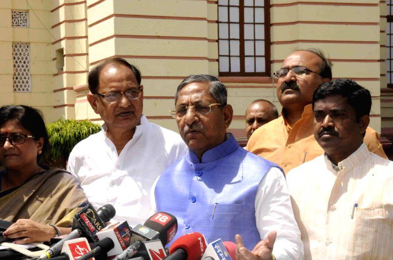 BJP legislator Nand Kishore Yadav addresses press at the Bihar assembly  in Patna, on April 6, 2015.
