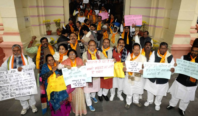 BJP legislators stage a demonstration at the Bihar Assembly premises in Patna, on Dec 23, 2014.