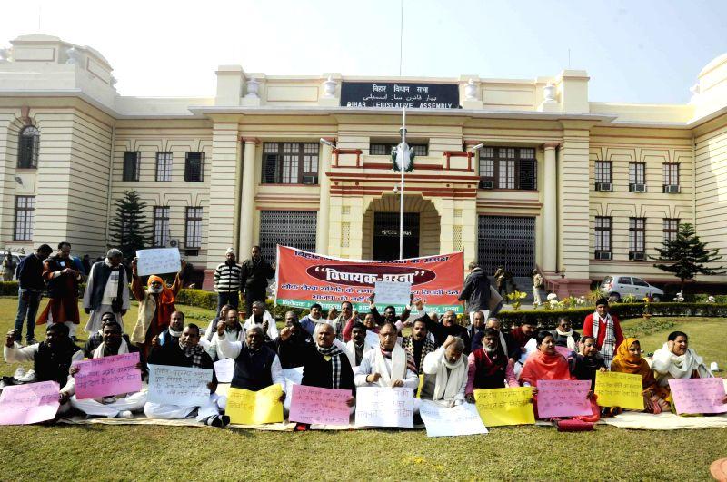 BJP legislators stage a demonstration at the Bihar Assembly Premises in Patna, on Dec 29, 2014.