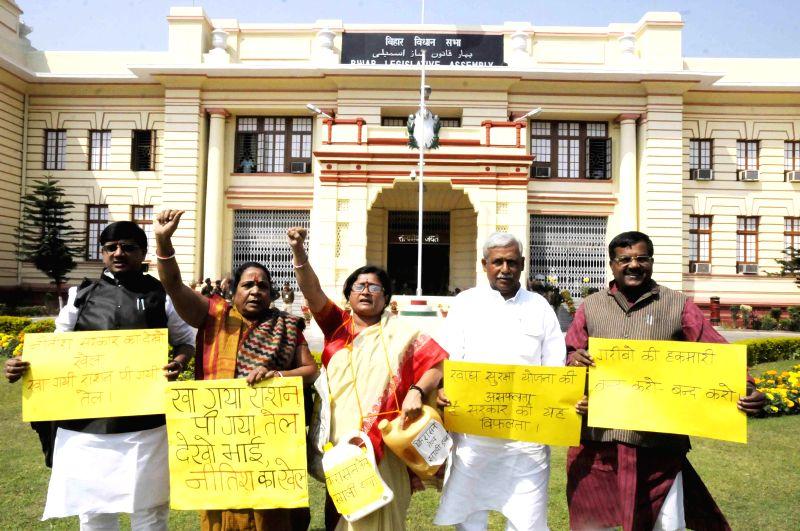 BJP legislators stage a demonstration at the Bihar Legislative Assembly in Patna, on March 13, 2015.