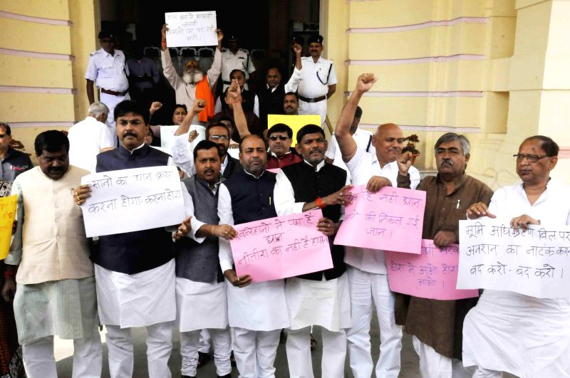 BJP legislators stage a demonstration at the Bihar Legislative Assembly in Patna, on March 16, 2015.