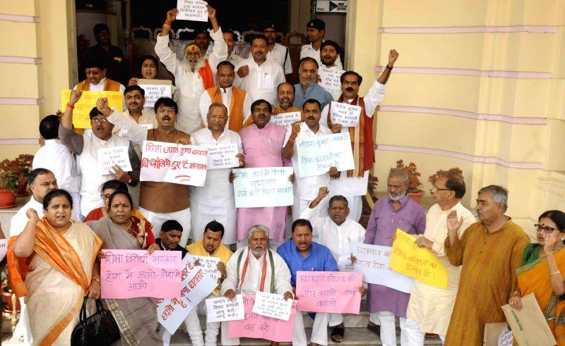 BJP legislators stage a demonstration at Bihar assembly in Patna on March 26, 2015.
