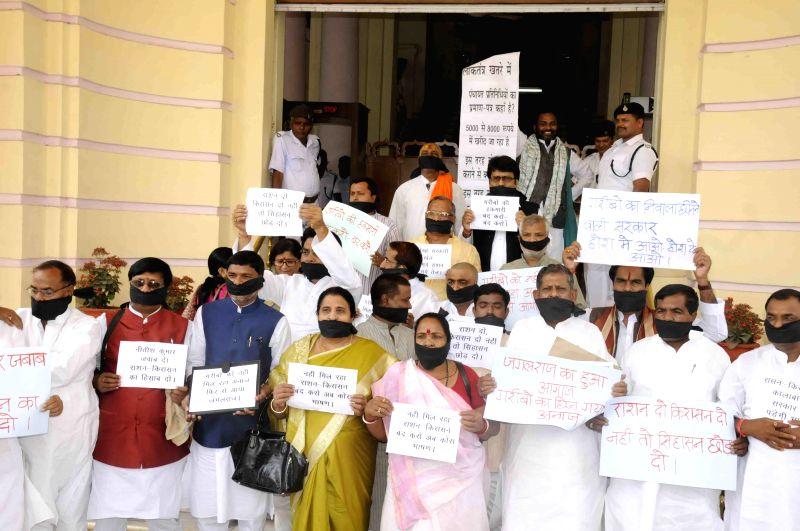 BJP legislators stage a demonstration at Bihar assembly in Patna, on April 6, 2015.