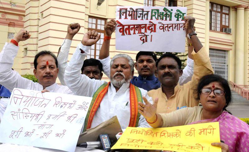 BJP legislators stage a demonstration at Bihar Assembly in Patna, on April 7, 2015.