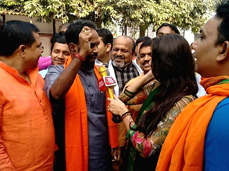 : Patna: BJP workers celebrate during the initial stage of Bihar assembly poll counting in Patna on Nov 8,2015. (Photo: IANS).