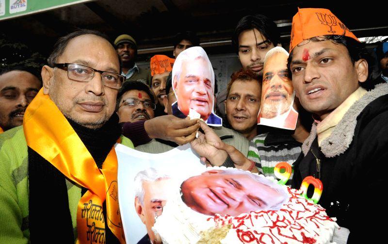 BJP workers celebrate former prime minister Atal Bihari Vajpayee's birthday in Patna  on Dec 25, 2014.