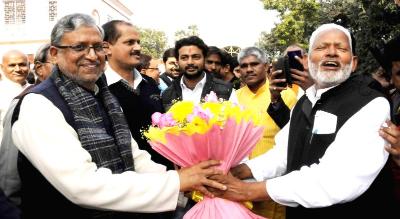 BJP workers greet party leader Sushil Kumar Modi on new year at his residence in Patna on Jan 1, 2015. - Sushil Kumar Modi