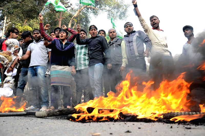 Chhatra Samagam students stage a demonstration against alleged beating-up of students by police in Arrah of Bihar,   in Patna, on Dec 1, 2014.