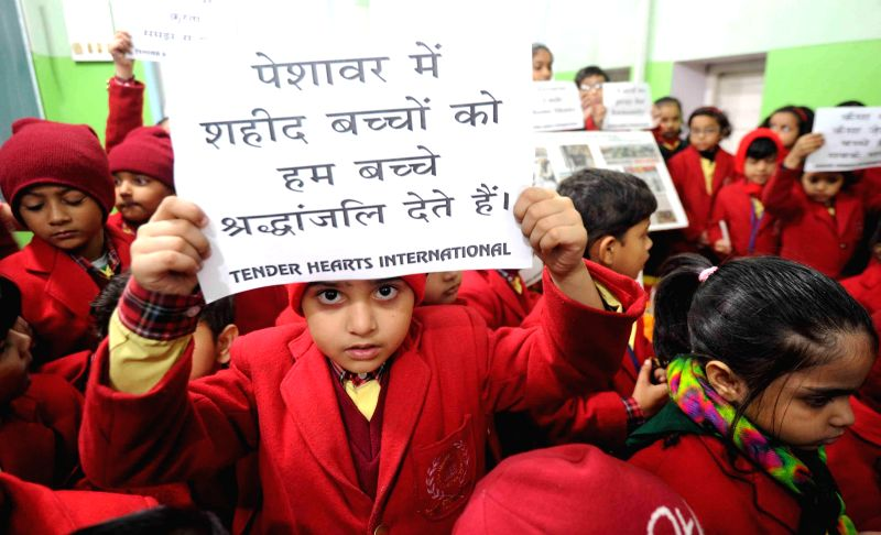 Children participate in a candlelight protest against Tuesday's attack on the Army Public School in Peshawar, Pakistan, that claimed 104 lives mostly those of children, in Patna, on Dec 17, ...