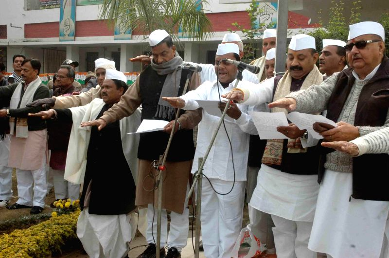 Congressmen participate in a programme organised on the foundation day of the party in Patna, on Dec 28, 2014.