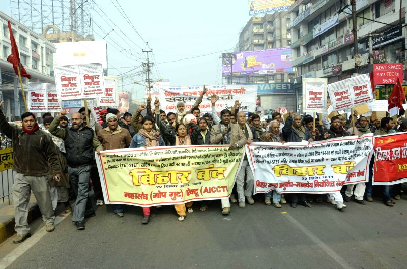 CPI(M) workers stage a protest rally during Bihar bandh in Patna, on Dec 22, 2014.
