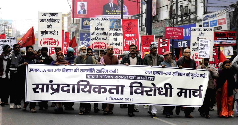 CPI (ML) activists take part in a rally to mark the 22nd anniversary of the demolition of Babri Masjid in Patna on Dec. 6, 2014.