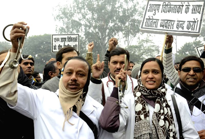 Doctors stage a demonstration in front of Bihar Legislative Assembly in Patna, on Dec 22, 2014.
