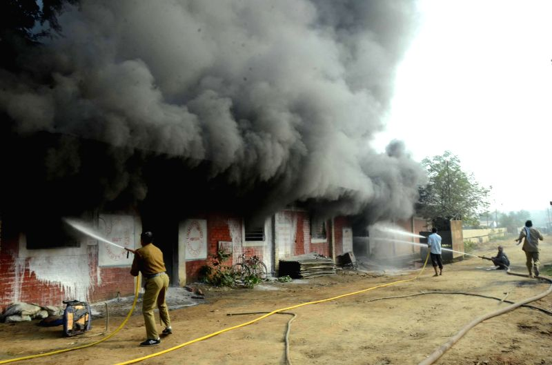 Fire fighters try to douse a major fire that broke out in a railway godown in Patna on Dec 10, 2014.