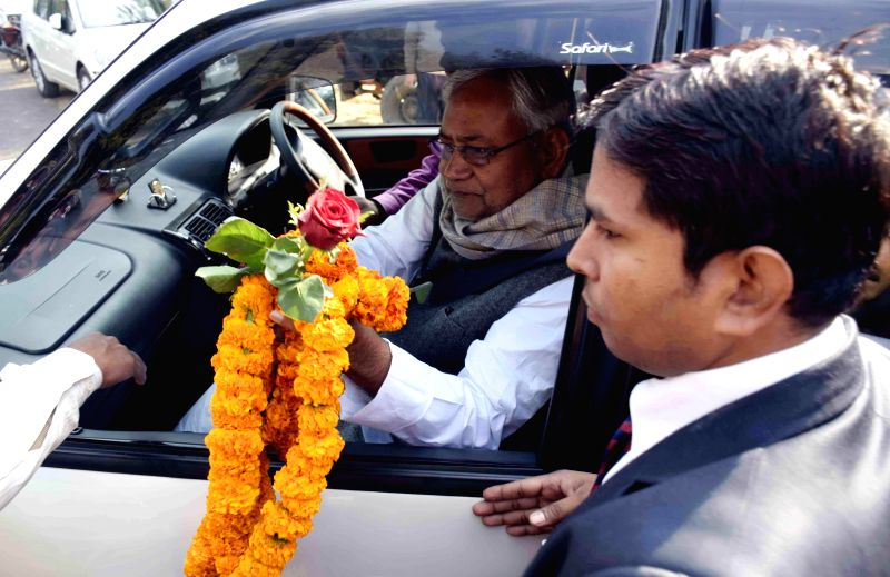 Former Bihar Chief Minister and and Janata Dal - United leader Nitish Kumar being greeted by a party worker on new year in Patna, on Jan 1, 2015.
