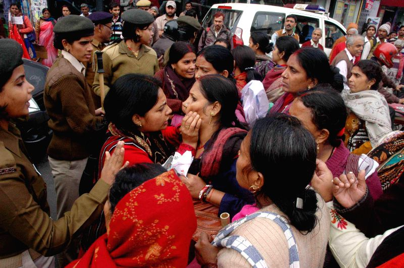 Integrated Child Development Services (ICDS) workers stage a demonstration to press for their demands in Patna, on Dec 4, 2014.