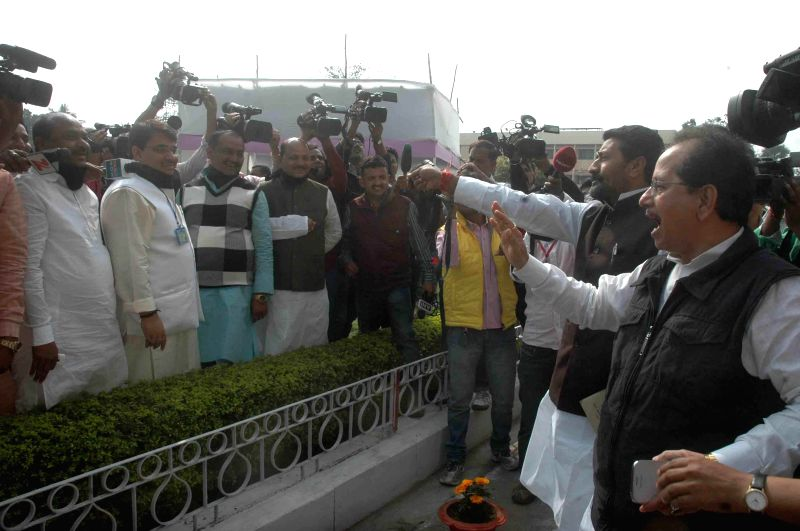 JD(U) and BJP leaders get involved in a verbal spat in front of Bihar Legislative Assembly in Patna, on Feb 20, 2015.