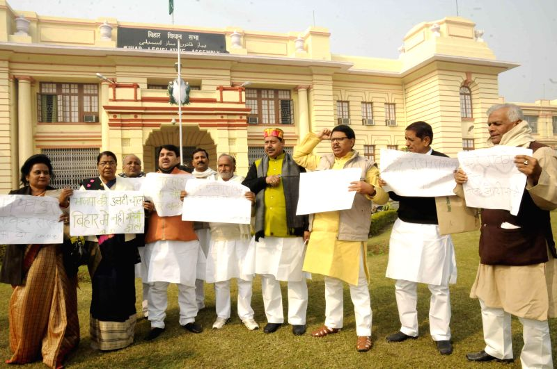 JD(U) and RJD legislators stage a demonstration at Bihar Legislative Assembly in Patna on Dec 26, 2014.