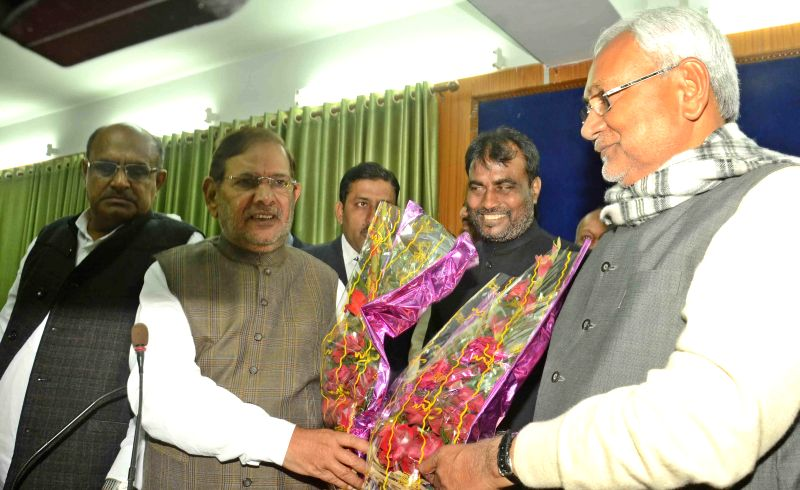 JD(U) chief Sharad Yadav congratulates party leader Nitish Kumar who was elected the new leader of the JD-U legislature party in Bihar, in Patna, on Feb 7, 2015. Also seen party leader K C ... - Sharad Yadav