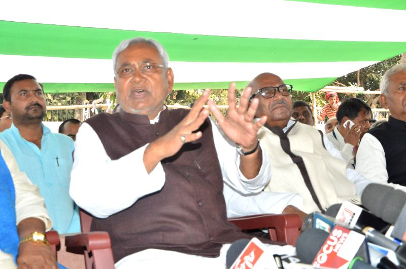 JD (U) leader Nitish Kumar addresses press regarding the resignation of Bihar Chief Minister Jitan Ram Majhi in Patna, on Feb 20, 2015. - Jitan Ram Majhi