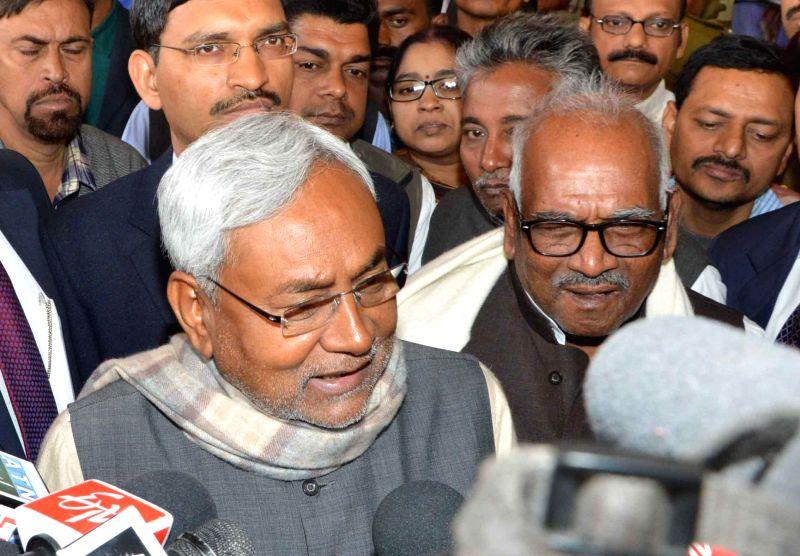 JD(U) leader Nitish Kumar addresses press at Patna Airport after returning from New Delhi on Feb 12, 2015.