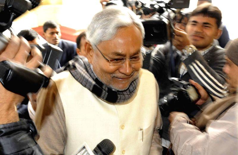 JD (U) leader Nitish Kumar arrives to attend the winter session of Bihar Legislative Assembly in Patna, on Dec 23, 2014.