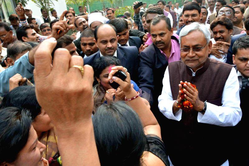 JD (U) leader Nitish Kumar meets his supporters in Patna, on Feb 20, 2015.