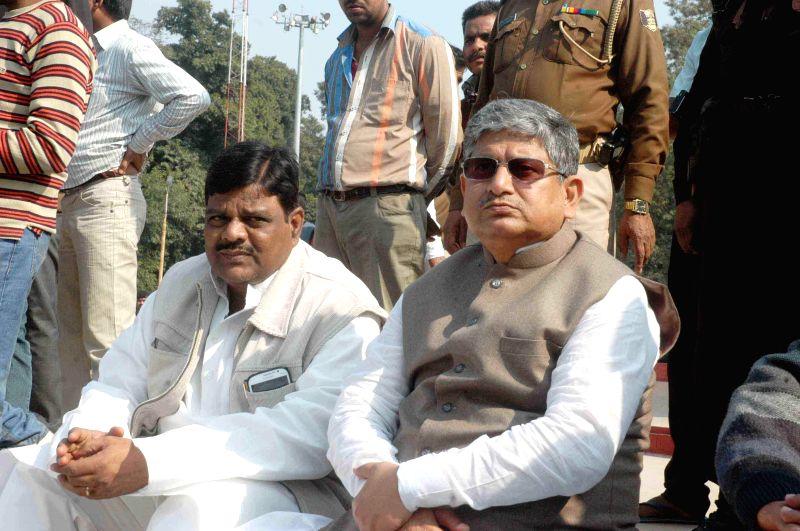 JD(U) leader Rajiv Ranjan Singh alias Lalan Singh - supporter of JD (U) leader Nitish Kumar - demonstrate outside Raj Bhawan in Patna, on Feb 9, 2015. - Rajiv Ranjan Singh, Lalan Singh and Nitish Kumar