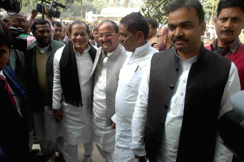JD(U) MLAs arrive at the residence of party leader Nitish Kumar to attend a party meeting in Patna, on Feb 7, 2015. - Nitish Kumar