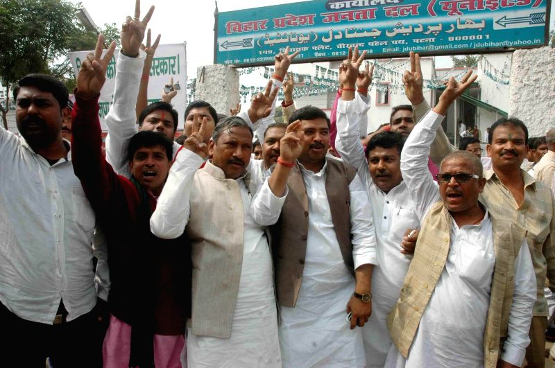 JD(U) workers celebrate after Bihar Chief Minister Jitan Ram Majhi resigned from his post, in Patna, on Feb 20, 2015. - Jitan Ram Majhi
