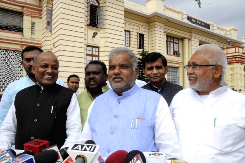 JDU legislators address a press conference at the Bihar Legislative Assembly in Patna, on March 16, 2015.