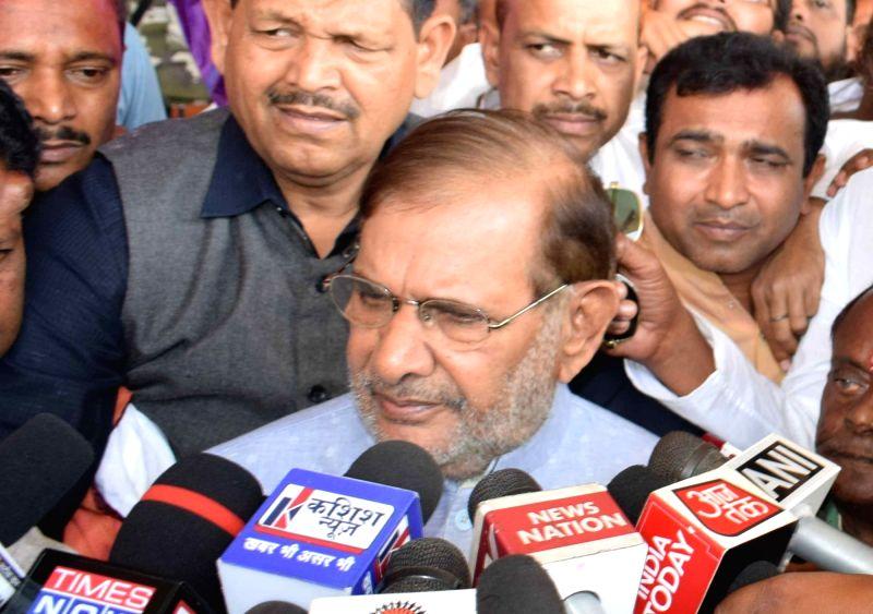 Patna: Loktantrik Janata Dal leader Sharad Yadav talks to media persons on his arrival at Jay Prakash Narayan International Airport in Patna, on March 22, 2019.