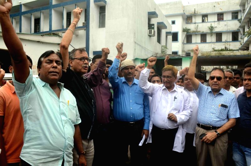 Patna Medical College and Hospital (PMCH) doctors stage a demonstration during a 12-hour nationwide protest by Indian Medical Association (IMA) against the National Medical Commission (NMC) ...
