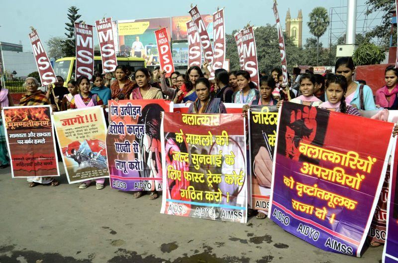 Members of All India Mahila Saskritik Sangathan  stage a demonstration to condemn 2012 Nirbhaya gangrape in Patna on Dec 16, 2014.