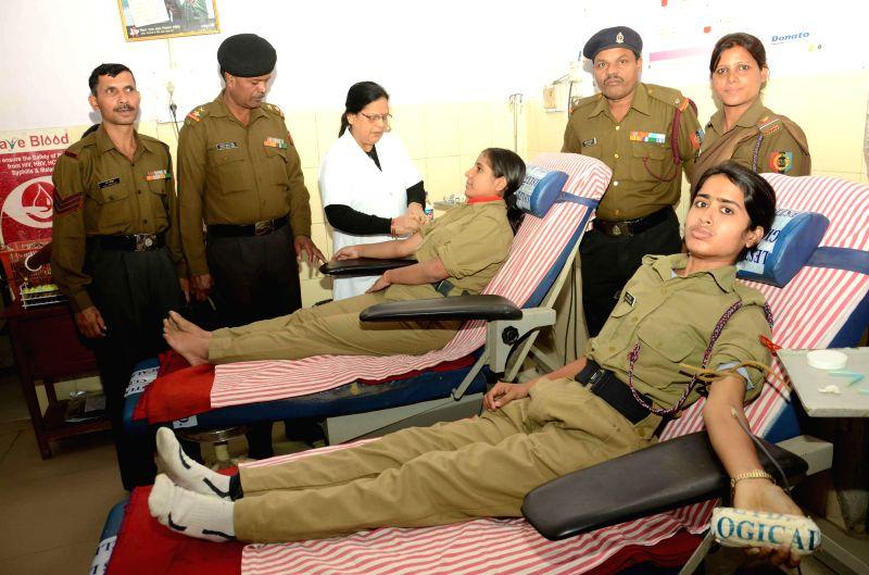 NCC cadets donate blood at a blood donation camp setup Patna Medical College and Hospital in Patna on Nov 26, 2014.