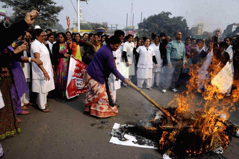 Nurses stage a demonstration against Bihar Chief Minister Jitan Ram Majhi in Patna, on Dec 8, 2014. - Jitan Ram Majhi