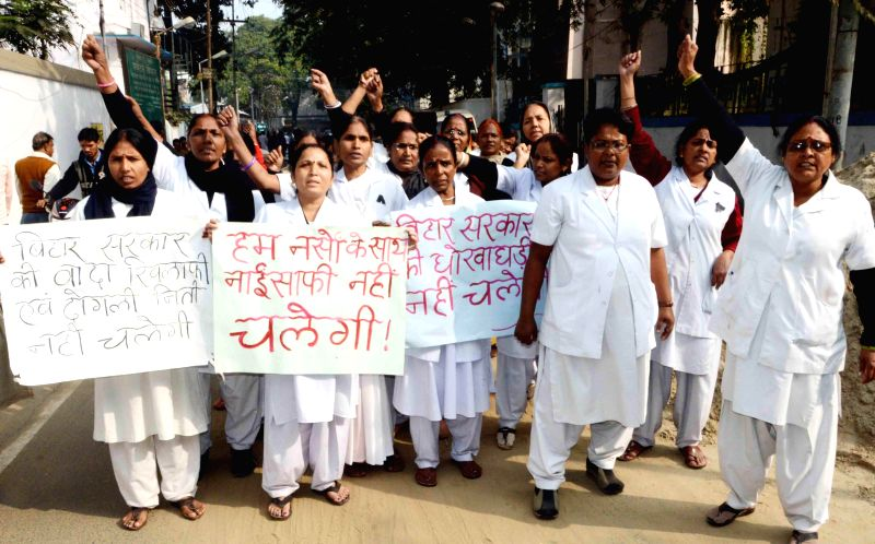 Patna Medical College and Hospital (PMCH) nurses stage a demonstration to press for their demands in Patna, on Dec 5, 2014.