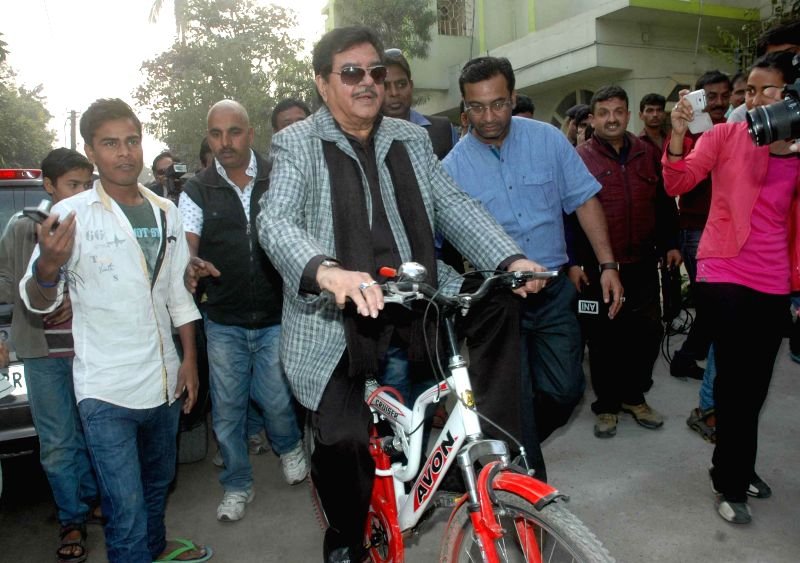 Patna Saheb MP and actor Shatughan Sinha rides a cycle at the inauguration of Dr. Rajender Prasad Memorial Lawn Tennis Tournament in Patna, on Dec 1, 2014.