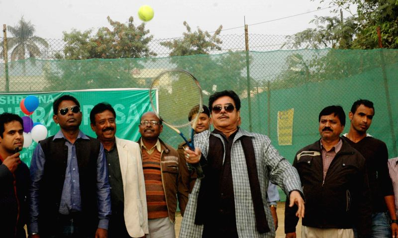 Patna Saheb MP and actor Shatughan Sinha in action at the inauguration of Dr. Rajender Prasad Memorial Lawn Tennis Tournament in Patna, on Dec 1, 2014.