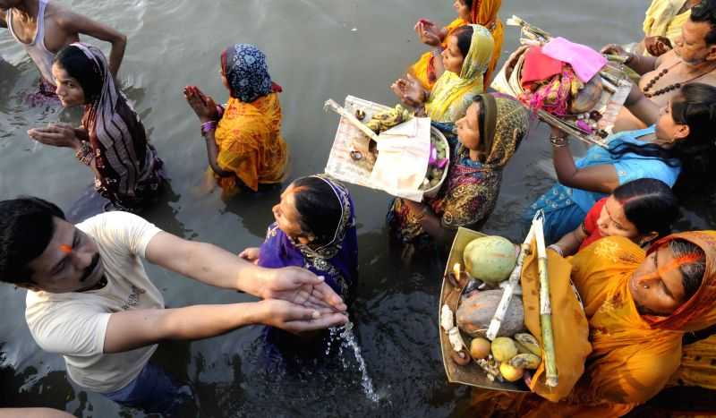 People celebrate Chaitya Chhath on the banks of Ganga river in Patna, on March 25, 2015.