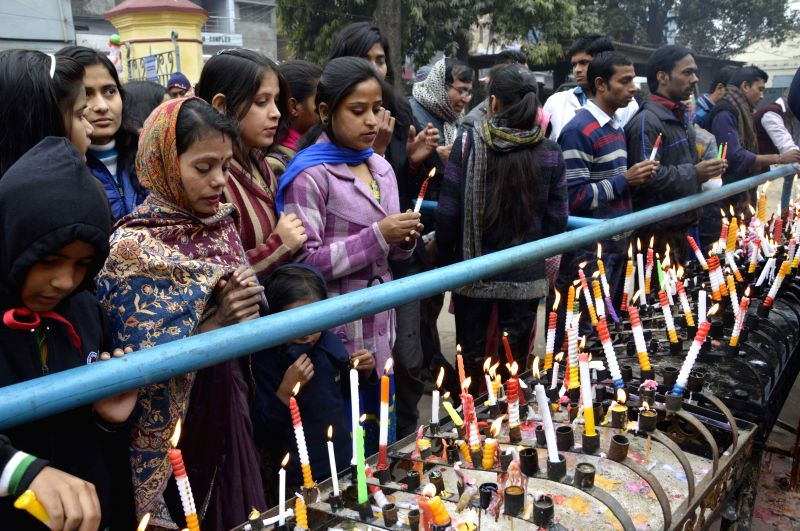 People light candles on Christmas at Patna Catholic Church on Dec 25, 2014.