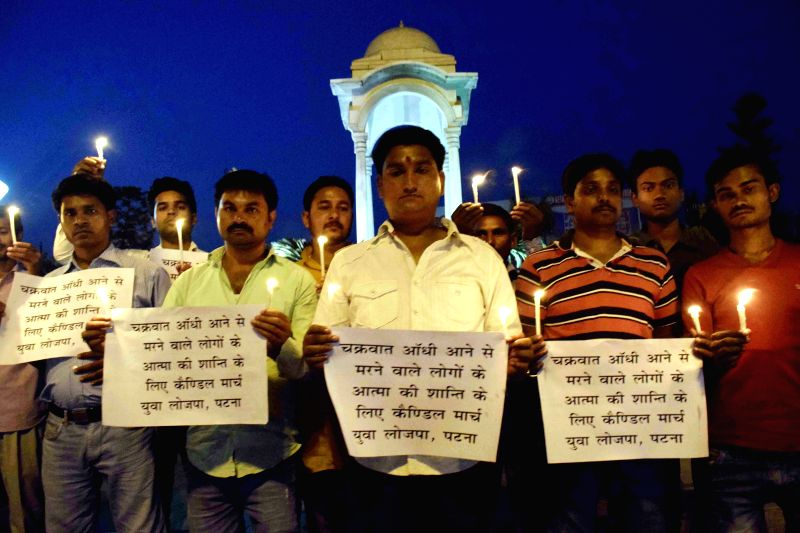 People pay tribute to the people killed in a storm that lashed several districts of Bihar late on Tuesday night (22nd April 2015); in Patna, on April 22, 2015.