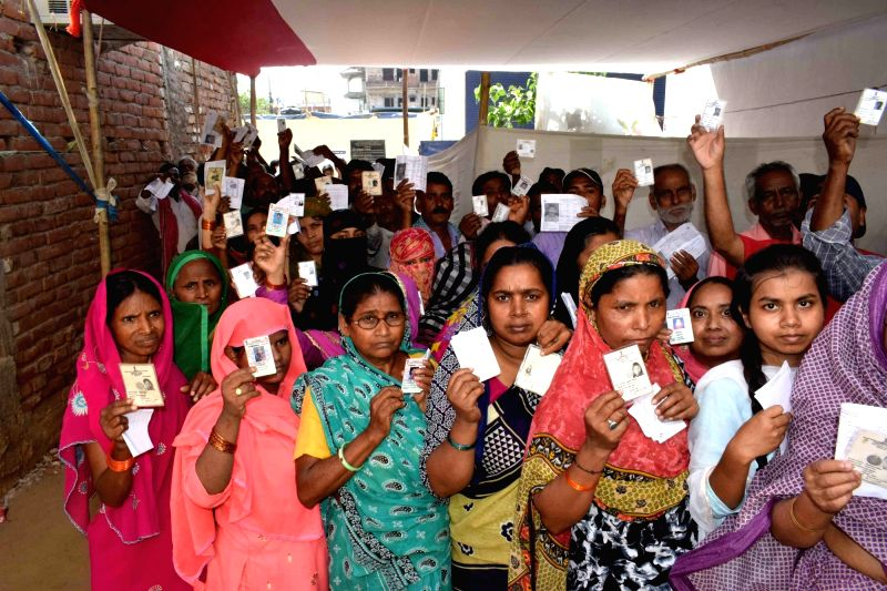 Patna: People queue-up to cast their votes during the seventh and the last phase of 2019 Lok Sabha Elections at a polling booth in Patna, on May 19, 2019. (Photo: IANS)