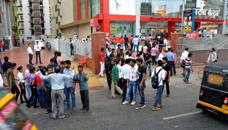 People rush out of their offices as earthquake jolts Patna on April 25, 2015.