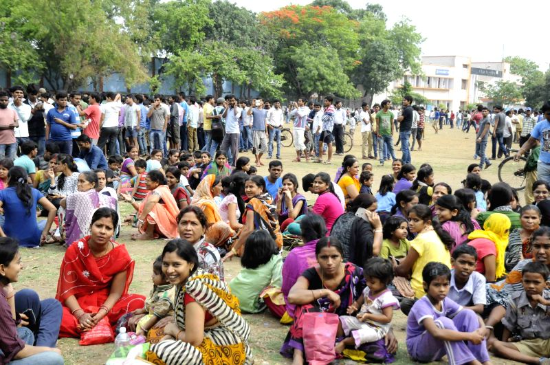 People take refuge in open grounds as earthquake jolts Patna on April 25, 2015.
