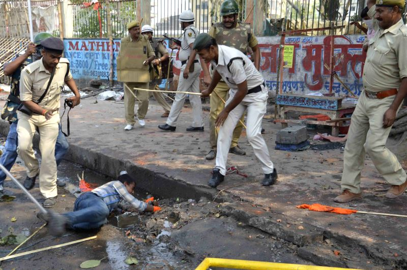 Policemen charge batons on ABVP activists staging a demonstration near state assembly in Patna, on March 26, 2015.