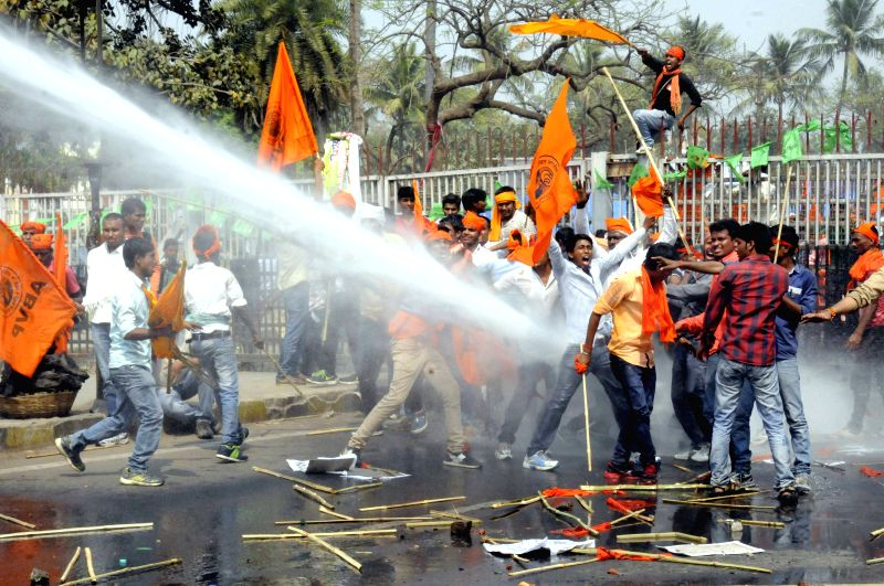Policemen charge water cannons on ABVP activists staging a demonstration near state assembly in Patna, on March 26, 2015.