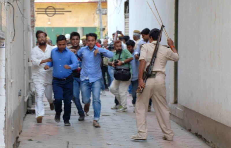Policemen chase TET qualified candidates staging a demonstration to press for their demands in Patna, on April 8, 2015.