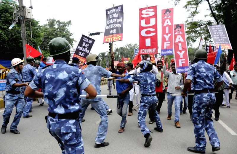 Patna: Rapid Action Force (RAF) personnel stop Left party workers as they stage a demonstration during a shutdown called by the Left parties in Bihar against the rape of 34 minor girls at a ...