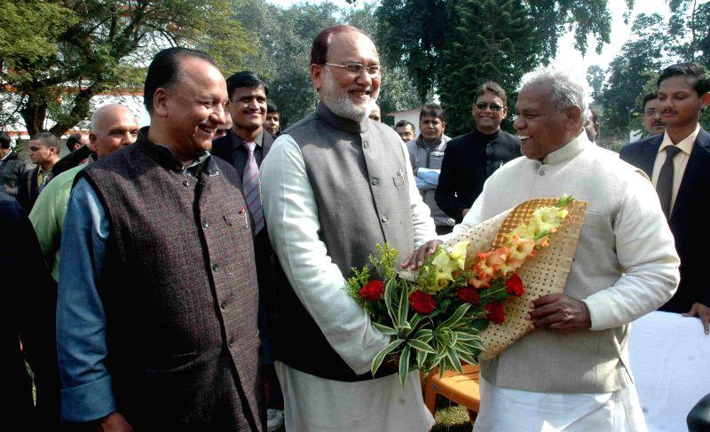RJD leader Abdul Bari Siddiqui wishes Bihar Chief Minister Jitan Ram Majhi on new year in Patna, on Jan 1, 2015. - Jitan Ram Majhi